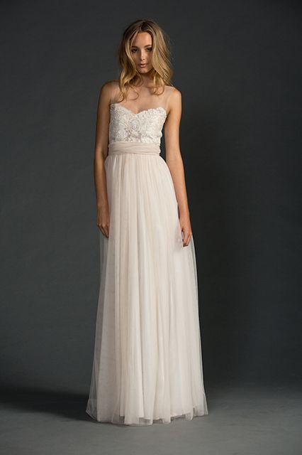11 Lace Wedding Dresses That Will Make You Believe In Love #refinery29  http://www.refinery29.com/lace-wedding-dresses#slide-5  For just a touch of lace, check out this dreamy nude dress. The bottom is soft and ethereal thanks to some flowy tulle, but the top is structured with a unique textured lace. And, while the sweetheart neckline and invisible mesh of the front are sure to wow your guests, it's the semi-sheer back of this beauty that will have them talking for months to come.