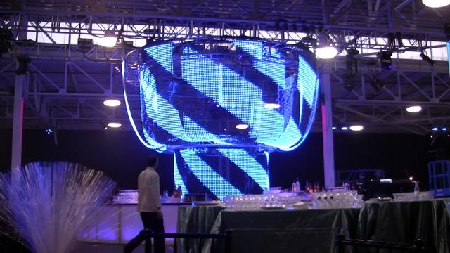 16 - 4'x 12' 50mm FlexiFlex panels and 8- 4'x 8' 50mm FlexiFlex panels hung vertically from truss in a cylindrical pattern at a 2011 Impact event in San Francisco.