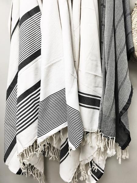 "White with black stripe fouta beach blanket Measures 76"" x 76"" 100% Cotton with large stripes and pom pom fringe"