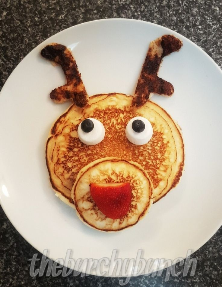 "All you need to create this simple reindeer is  - 2 x pancakes - one large and one smaller to make the face - A strawberry cut in half will be your nose - 2 x Marshmallows for eyes - 2x blueberry pupils  And to make your antlers all you need is  - a slice of toast (i topped mine with vegemite).  Using a cookie cutter cut a gingerbread man out of your toast. Then rotate your ""gingerbread man"" 180 and cut it in half.... ANTLERS!"