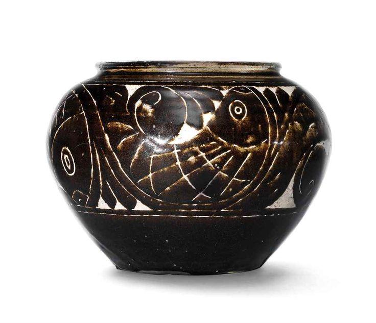 A Cizhou cut-glaze 'Fish' jar, Jin dynasty (1115-1234)