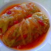 "This recipe is close to my Mom's recipe for cabbage rolls (with a few slight changes in ingredients, i.e, she used onion instead of garlic in the meat mixture, and I don't think she used parsley.)  **The real secret to the great taste of her cabbage rolls was that she placed them on a bed of sauerkraut instead of just extra cabbage.  I miss her ""German inspired"" dishes so much... but not nearly as much as I miss her still being a part of my life."