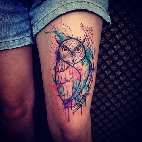 watercolor owl tattoo on thigh