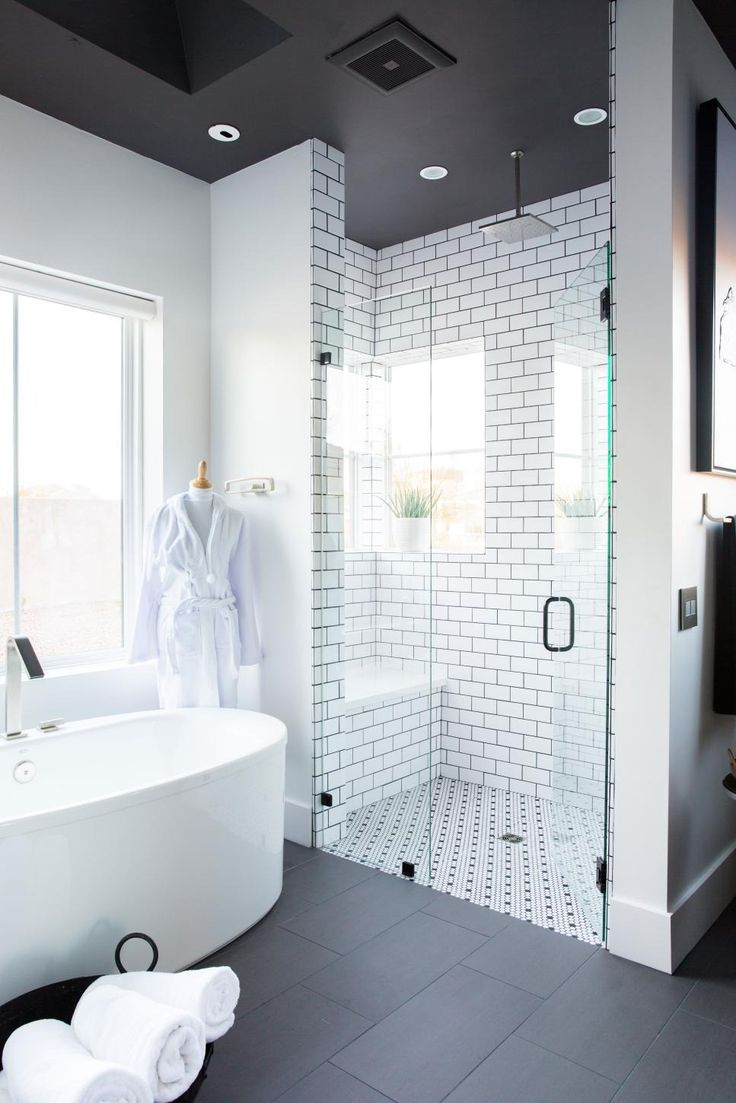 This luxurious master bath with high-tech features for the ultimate pampering experience has a classic black-and-white color scheme that was given a fresh spin with dueling tile patterns. >> http://www.hgtv.com/design/hgtv-smart-home/2017/master-bathroom-pictures-from-hgtv-smart-home-2017-pictures?soc=pinterest