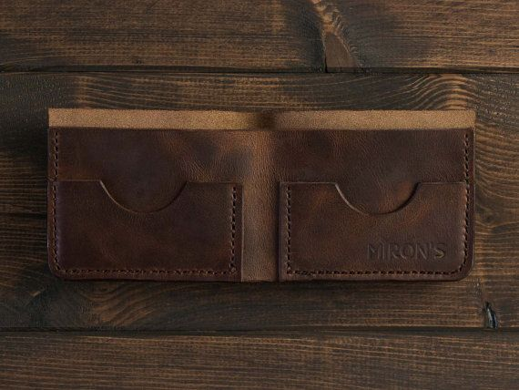 This aesthetically pleasing and elegant wallet is made for people who appreciate style and quality. We use tanned leather to craft this item. The bifold wallet has plenty of room for cash and the two pockets can accommodate up to four cards.