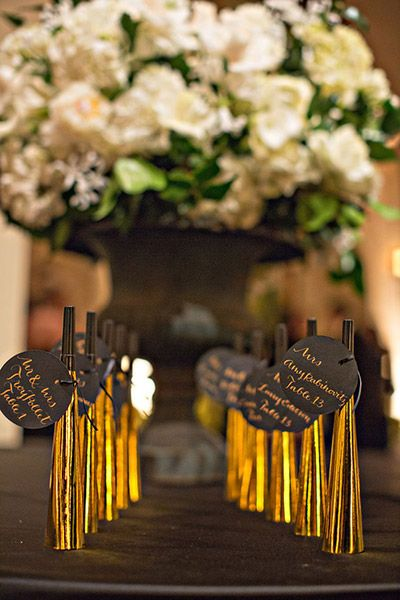 Use your escort card table as an opportunity to get creative, like with these New Year's Eve noisemakers.