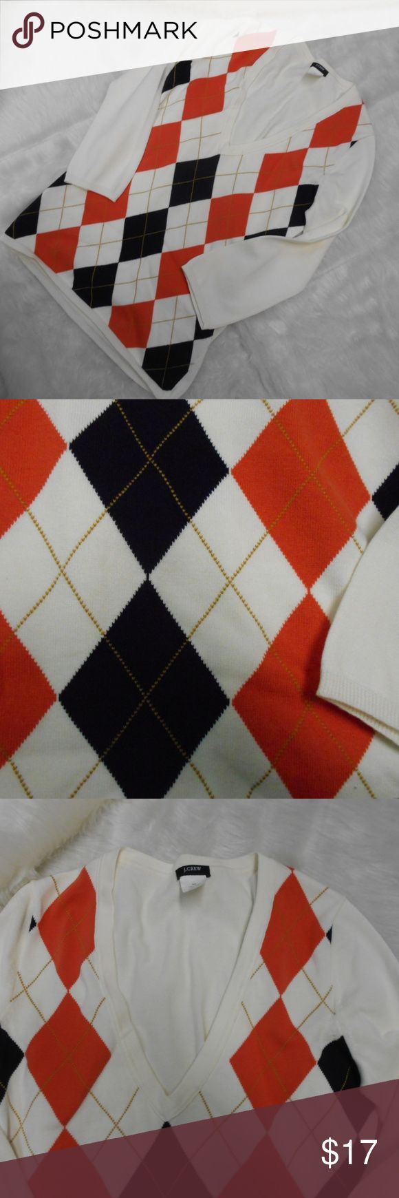 "J Crew Argyle Sweater Orange/Black/Gold; 3/4 sleev Lovely argyle sweater.  Orange & black with gold details.  Long sleeve, V-neck, 1/2"" ribbing at sleeve and hemline.  Pristine condition.  From smoke free home 16"" armpit to armpit; 15"" side to side at bottom;  17"" sleeve 3/4 length; 23"" long from back neck to hem.  100% cotton J. Crew Sweaters"