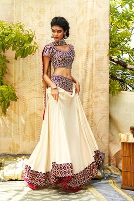 Light Lehengas - Cream and Purple Print Lehenga | WedMeGood Cream Lehenga with Purple and Red Print Border, and Purple and Red Sleeves Blouse. #wedmegood #red #purple #lehenga