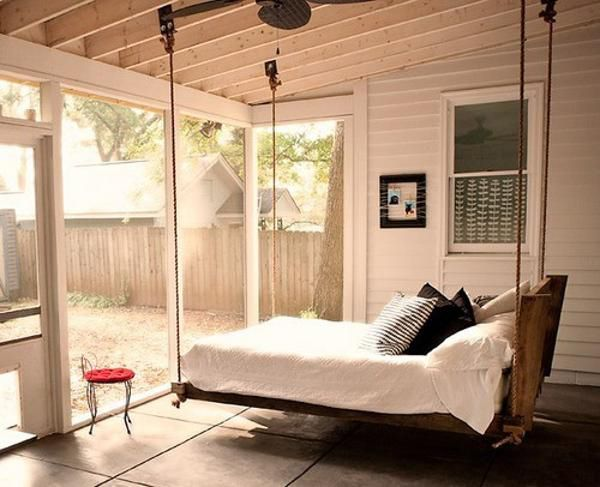 porch swing bed in an outdoor screened porch