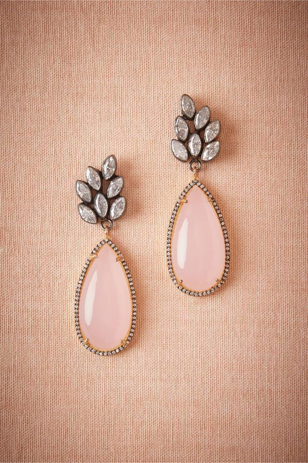 Pink chalcedony teardrops slip from a cluster of sparkling zircon stones on this stunning pair.