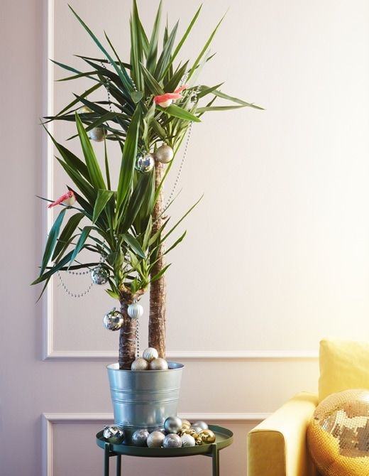 Try a faux Christmas tree this holiday! Just put a plant into a pot