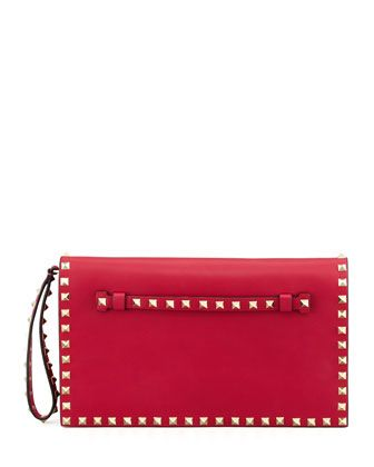 Rockstud All-Around Flap Wristlet Clutch Bag, Pink by Valentino at Bergdorf Goodman.