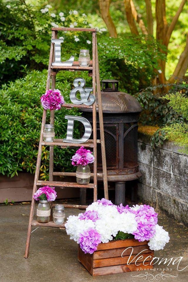 A ladder display is a creative way to add height to your wedding decor! #weddings #weddingdecor