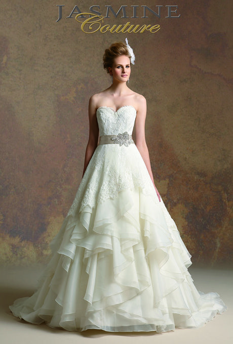 Brides.com: Jasmine Couture - Spring 2013 Style T152007, strapless satin trumpet wedding dress with a sweetheart neckline, pleated bodice, and beaded accents, Jasmine Couture  See more Jasmine Couture wedding dresses in our gallery.Photo: Courtesy of Jasmine Couture
