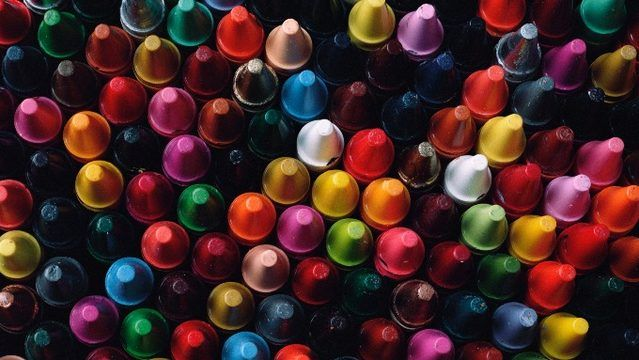 Crayola to retire shade from 24-count box on National Crayon Day 3/31/17 The box includes the following shades: apricot, black, blue, blue green, blue violet, brown, carnation pink, cerulean, dandelion, gray, green, green yellow, indigo, orange, red, red orange, red violet, scarlet, violet, violet red, white, yellow, yellow green and yellow orange.