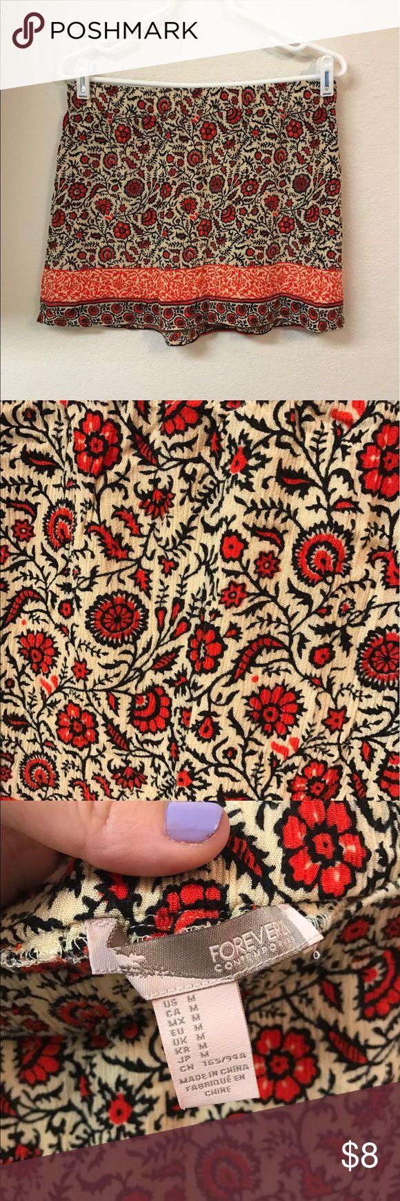 Forever 21 Floral Skirt From forever 21's contemporary collection.  100% Rayon   #forever21 #floralskirt #skirt  #midiskirt #sizemedium #mediumskirt #boho #bohemian #bohoskirt #bohemianskirt #medium Forever 21 Skirts Mini