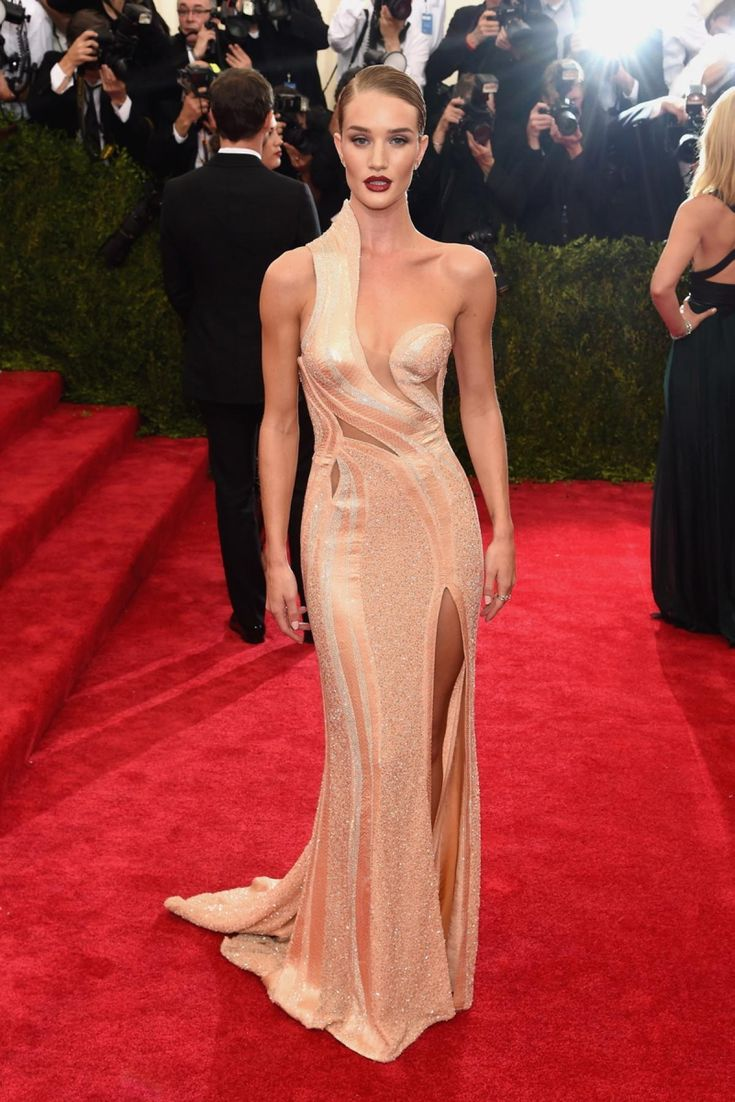 """Model Rosie Huntington-Whiteley showed off her perfect figure in this nude colored Atelier Versace dress for the """"China: Through The Looking Glass"""" Costume Institute Benefit Gala at the Metropolitan Museum of Art on May 4, 2015."""