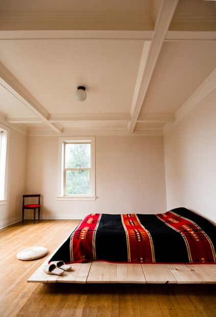 platform bed with a Navajo blanket - swoon