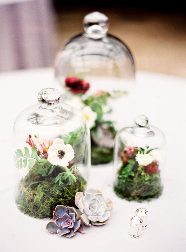 Centerpiece idea- floral arrangements in glass cake stands with dome covers! (garden