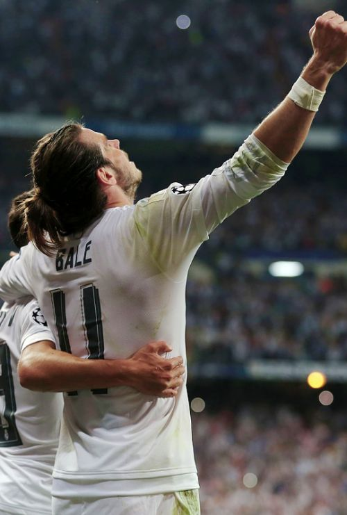 Gareth Bale celebrates their victory at the end the UEFA Champions League semi-final second leg football match Real Madrid CF vs Manchester City FC at the Santiago Bernabeu stadium in Madrid, on May 4, 2016.