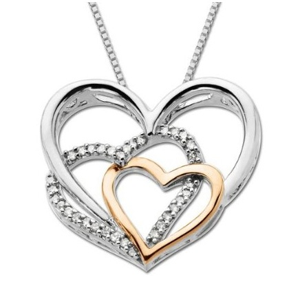 Sterling silver and 14k pink gold diamond triple heart pendant necklace.