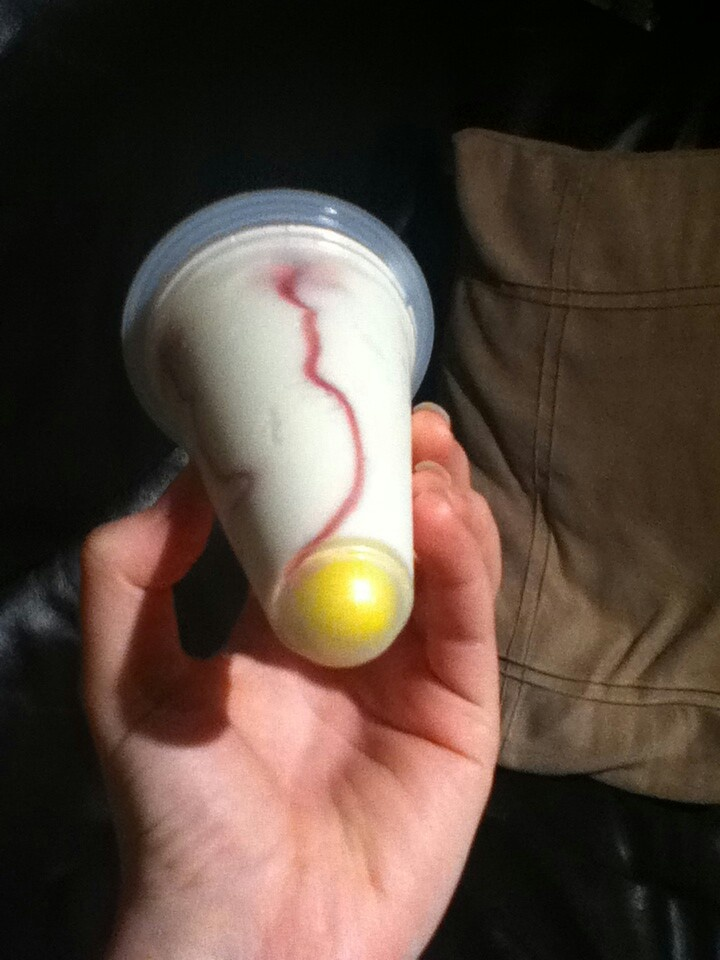 Screwball ice cream: vanilla ice cream with colored gumball in the bottom of the plastic cup