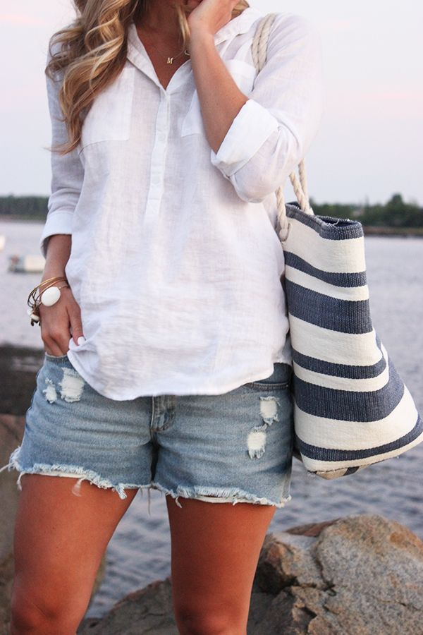 ...perfect summer style... a cool white linen shirt and distressed denim shorts. Love the bag too!