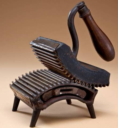 Dion Rocker Fluter - a type of iron, with a slug heated on the stove, that pressed in pleats or gathers for ruffles