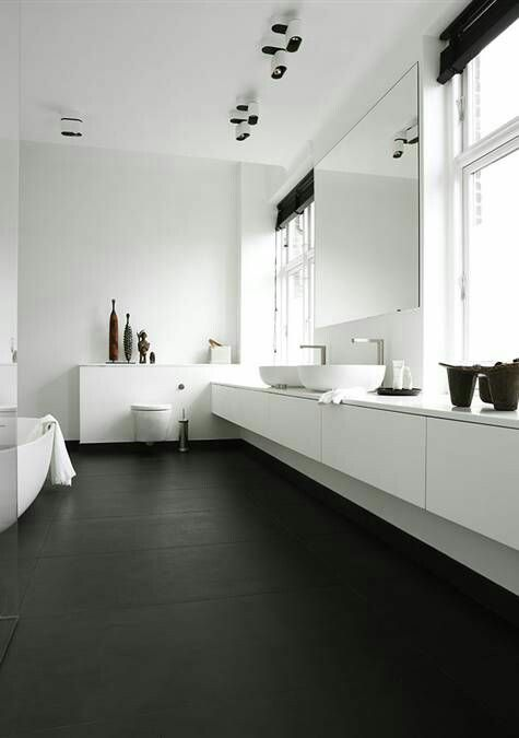 Light, lofty bathroom spaces. Opposite of the expected; dark flooring and lighter furnishings with dark accents. Monochrome.