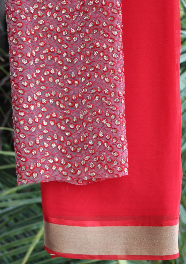 Red saree with embroidered blouse piece