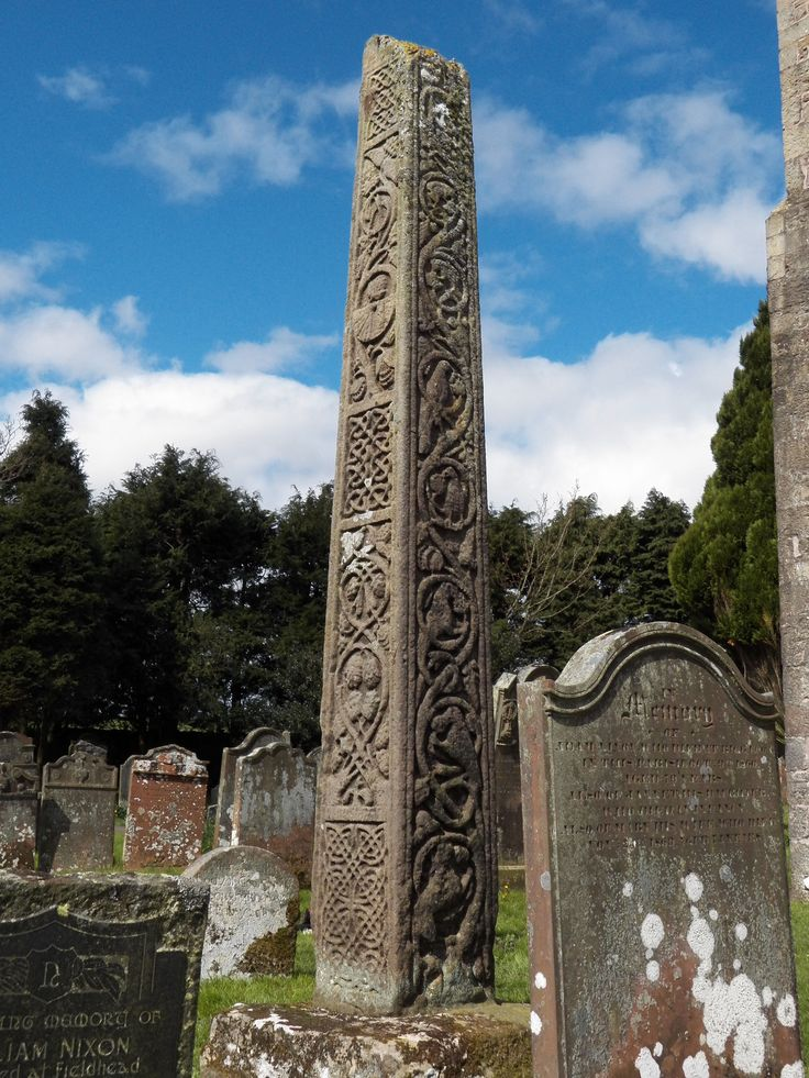"""The Bewcastle Cross is an Anglo-Saxon cross which is still in its original position within the churchyard of St Cuthbert's church at Bewcastle, in the English county of Cumbria. The cross, which probably dates from the 7th or early 8th century, features reliefs and inscriptions in the runic alphabet. The head of the cross is missing but the remains are 14.5 feet (4.4 metres) high, and almost square in section (56 x 54 cm at the base). ""Viking Anglosaxon, Anglosaxon Art, Bewcastl, Anglo Saxon"