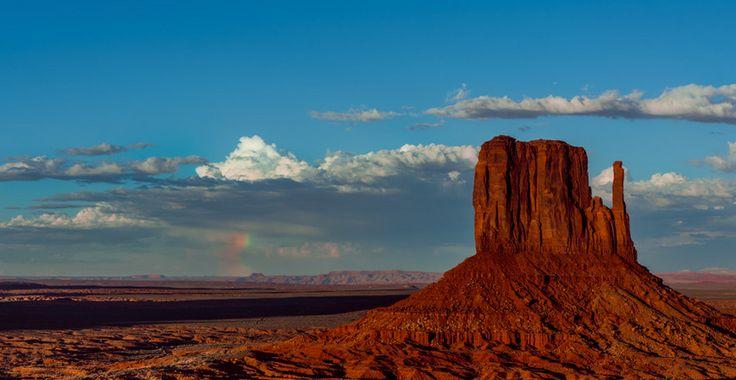 aquí podemos ver una foto del gran cañón y en el fondo un arcoiris