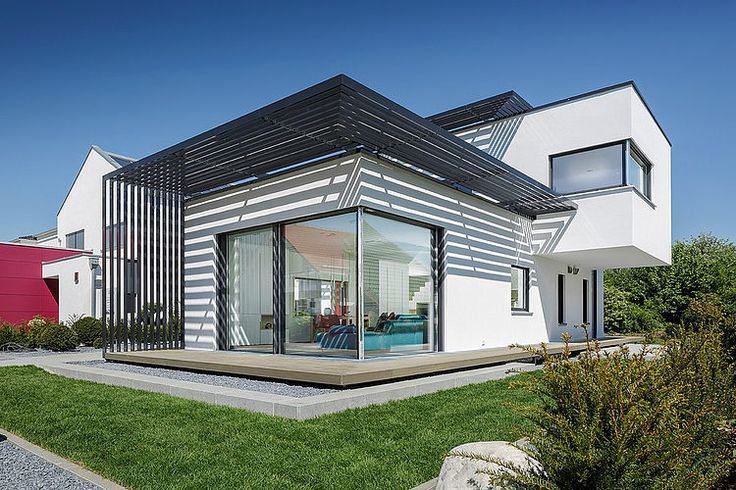 Poing House by Luxhaus. Modern 1,184 sq ft concept house designed by Luxhaus is located in the German city of Munich.