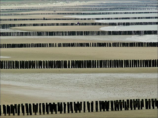 Wave breakers at the beach of Cadzand, Zeeland in The Netherlands.