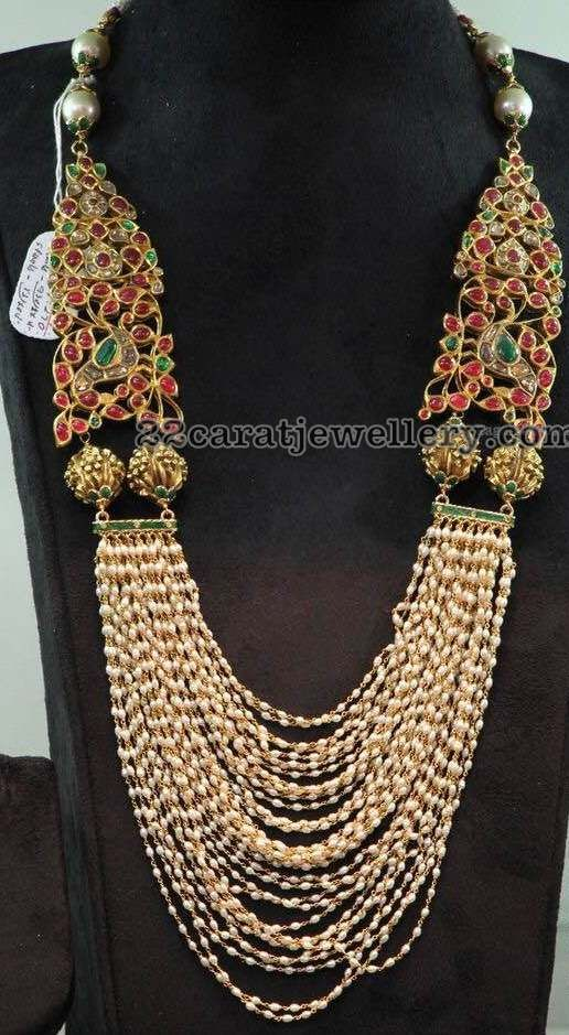 Multi strings basara pearls long set with 22 carat gold metal, Very large and trendy kundan motifs attached on the two sides of the edges...
