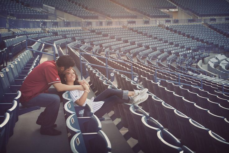 Baseball stadium engagement photos by Solis Pro. At Last Wedding + Event Design