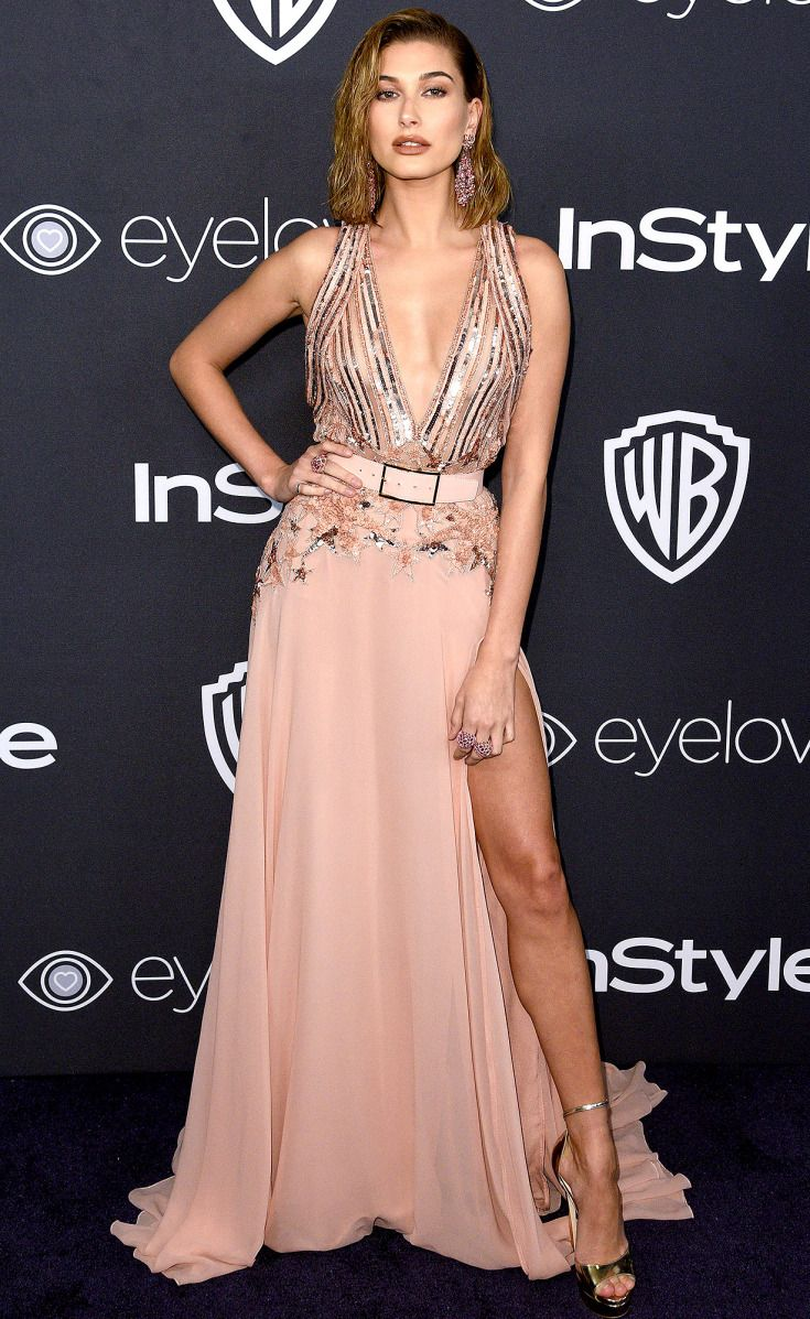 HAILEY BALDWIN wears a blush belted and embellished Elie Saab with Jimmy Choo heels and Lorraine Schwartz jewelery to the InStyle Party.