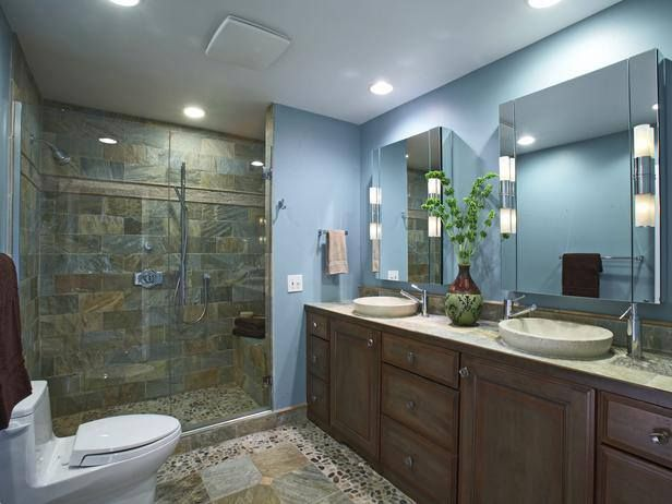Bathroom Flooring Idea For Today  River Rock Floor A river rock floor is a less expensive way to add a luxurious look to a bathroom. Designer Mark Zancanaro paired the floor with slate and tumbled marble shower walls for a cohesive look.  Photo by: Mark Zancanaro Design - Interior Design - Chicago