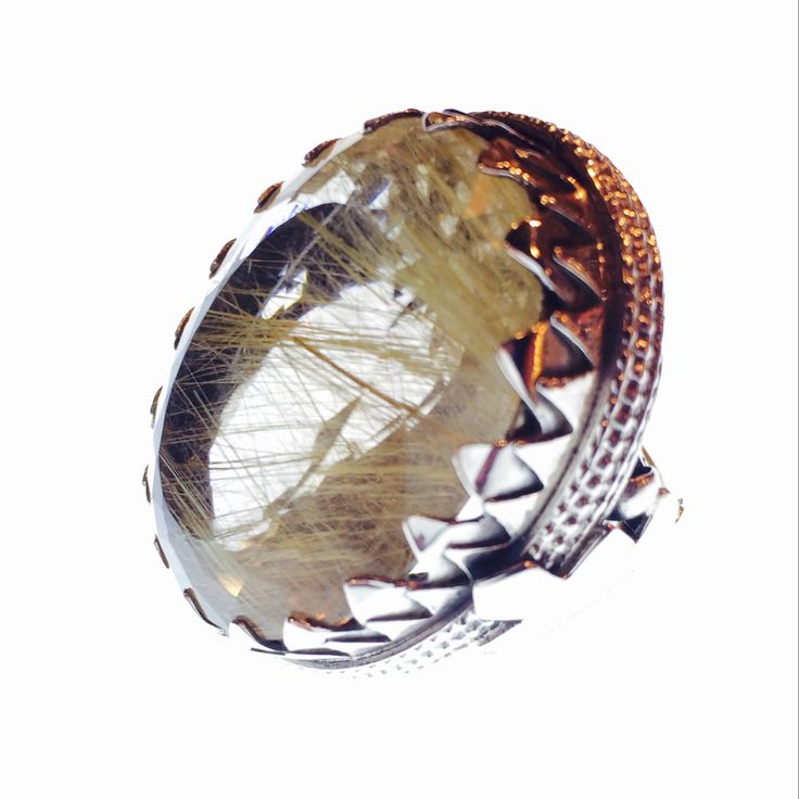 Rutilated quartz large crystal ring.