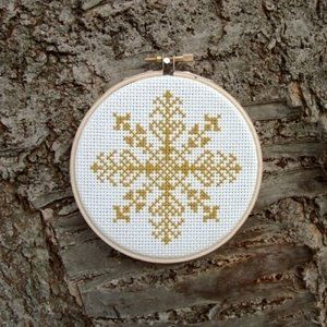 snowflake cross stitch - use navy cloth and silver thread; red cloth and white thread