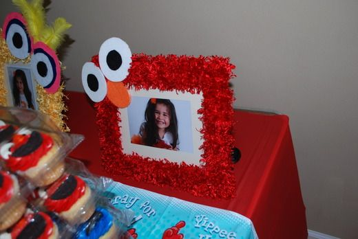 Michaela LOVES Elmo. We have to do this!