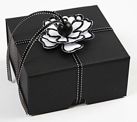 Paper flower for gift wrapping a box.