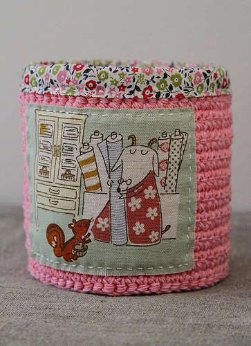 Plushka shows how you can really show off the beauty of small fabric samples by using them to embellish crochet baskets and containers.