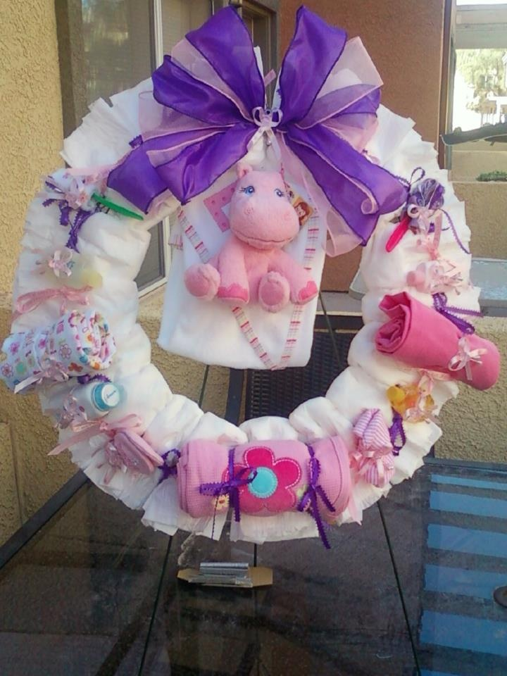 I made this for friends baby shower. Includes 16 size 1 diapers, 2 onesies, hooded towel, 1 blanket, travel sized-powder, baby bath, lotion, 2 wash cloth roses, 2 mittens, 1 hat, 1 hippo stuffed animal.
