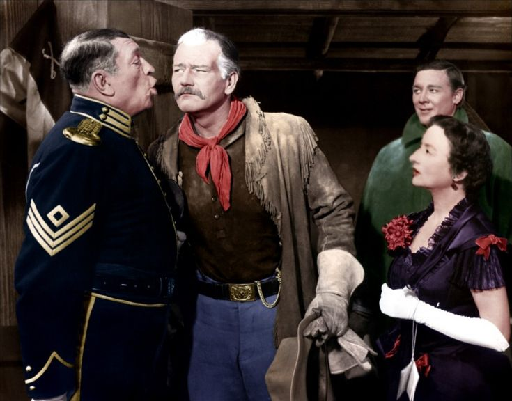 SHE WORE A YELLOW RIBBON (1949) - John Wayne checks for whiskey on Victor McLaglen's breath while Ben Johnson & Mildred Natwick watch - Directed by John Ford