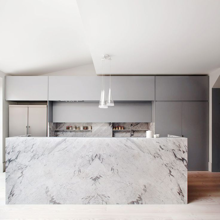 20 of the Most Stunning Modern Marble Kitchens via @MyDomaine  This marble's varying grayscale serves as the main centerpiece of this modern London kitchen.
