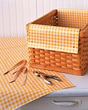 Martha Stewart no-sew basket liner:  using oilcloth, a hole punch, and ribbon