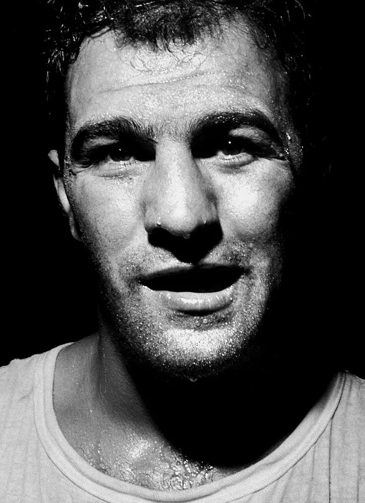 Rocky Marciano (1923-1969) was an American professional boxer and the World Heavyweight Champion from 1952 to 1956. The only world heavyweight boxing champion to retire undefeated, his 49 victories featured 43 knockouts and on the way he beat such great fighters as Joe Louis, Jersey Joe Walcott, Roland La Starza, and Ezzard Charles. The Rock died in a light plane crash just short of his 46th birthday.