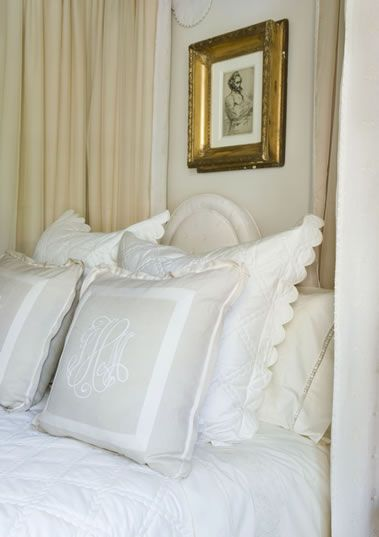 Monochromatic monogram on the front pillows of the bed are so pretty.