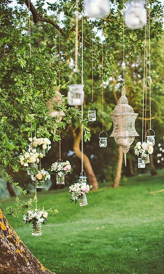 Add an ethereal touch to proceedings with flower-filled jars hanging off tree branches.  Photo | Les Amis